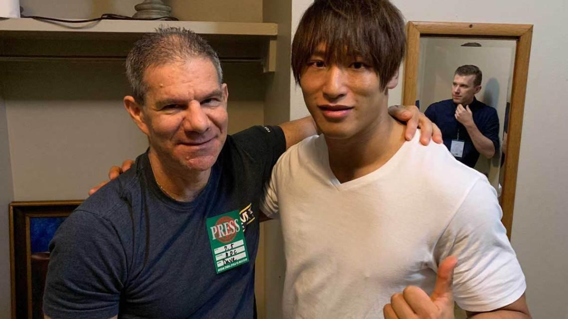 Wrestling Observer's Dave Meltzer (left) with wrestler Kota Ibushi (right).