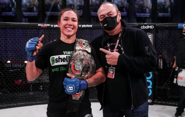 Bellator flyweight champion Juliana Velasquez with Bellator President Scott Coker. Photo courtesy of Bellator MMA.