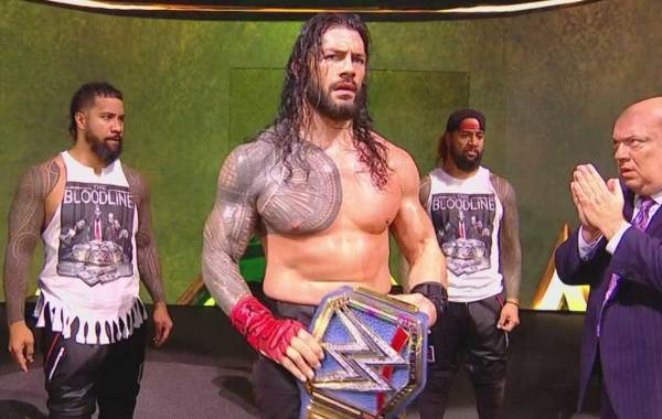 WWEUniversal Champion Roman Reigns with Paul Heyman and The Usos. Courtesy of WWE.com.