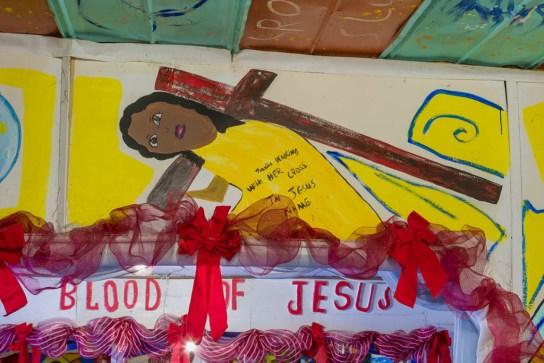 "Church detail: ""Juanita Walking With HER CROSS"""
