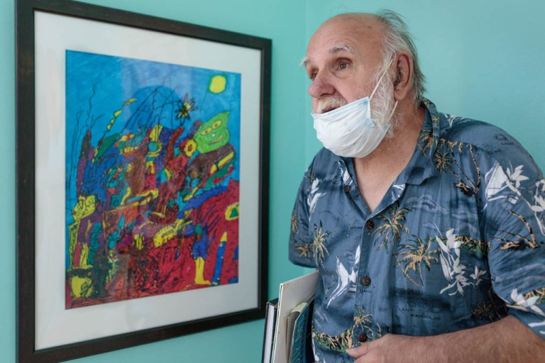 Frank Novel with his work, Erie Art Museum's 97th Annual Spring Show