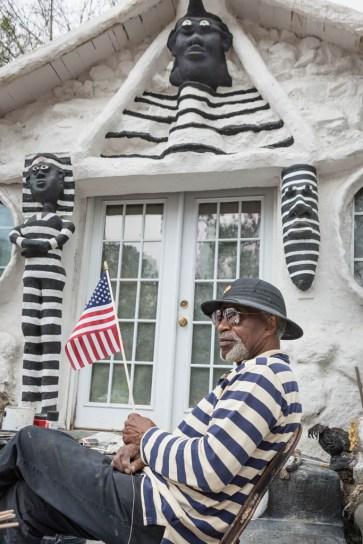 Dr. Charles Smith (dark American flag/prison/slave stripes; Hammond, LA 2015