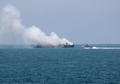 Smokes rises from an Egyptian coastguard vessel on the coast of northern Sinai, as seen from the border of southern Gaza Strip with Egypt