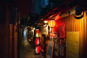 japanese cafes on empty narrow street in evening