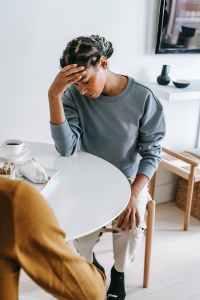 sad black woman at table with boyfriend