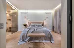 bedroom interior with bed near pouf