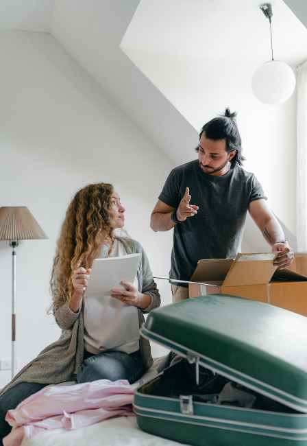 couple preparing baggage for moving according to checklist