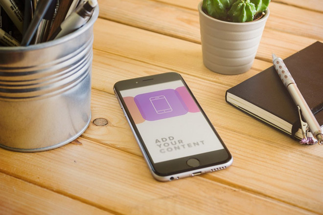 Free Realistic iPhone 6 Mockup on Wooden Table