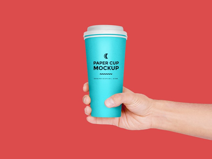 Free Paper Cup in Hand Mockup PSD
