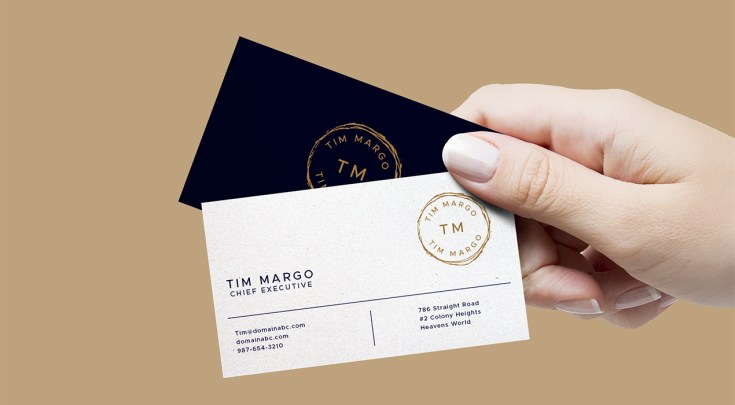 Free Hand Holding Business Cards Mockup PSD