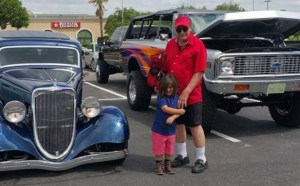 Grandpa Charlie with Brittany's son, King, at a car rally, 2017