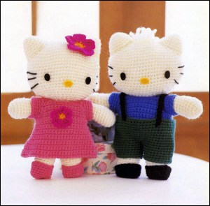 Hello Kitty crochet doll next to your boyfriend standing looking at you