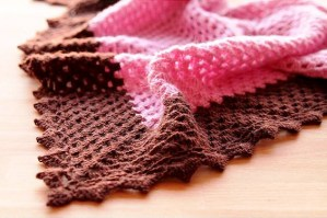 Step by step of a crochet shawl being produced by a woman