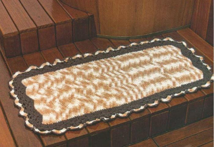 Crochet rug on top of a wooden floor in a rustic setting