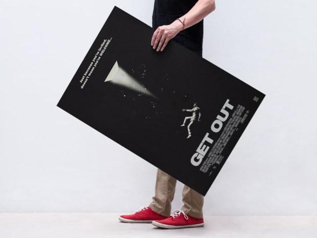 Free PSD Man Holding Poster Mockup