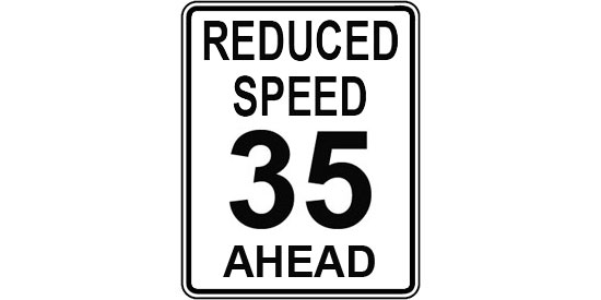 Reduced speed limit ahead - old regulatory sign