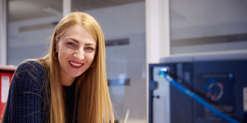 Woman at a computer station