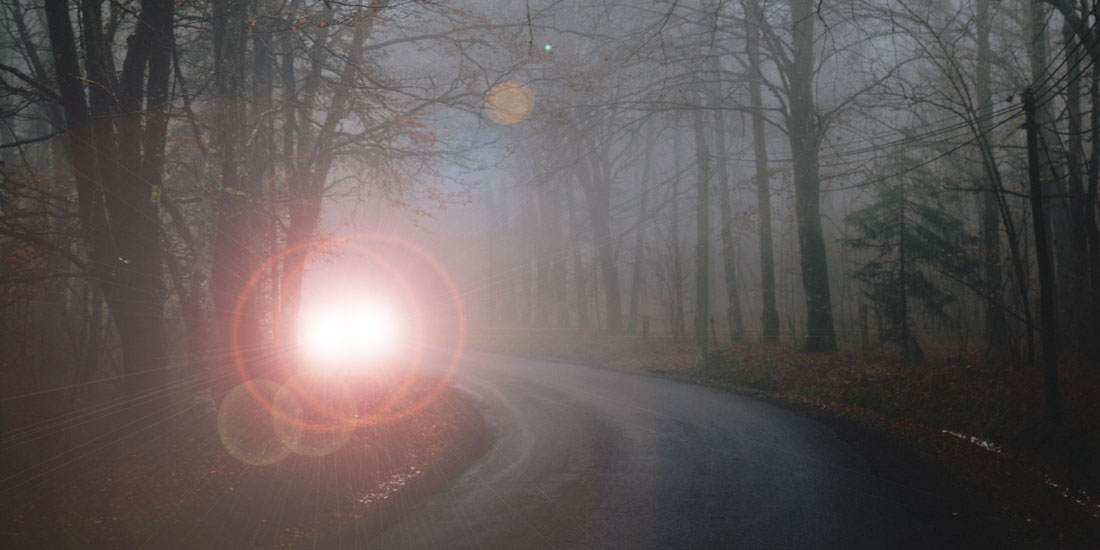 Oncoming vehicle with headlights on high beams - Photo by Louis from Pexels