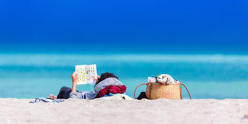 Reading on the beach: Photo by Go to Dan Dumitriu's profile Dan Dumitriu