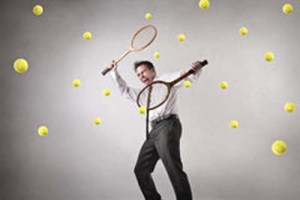 businessman-playing-tennis-hitting-balls-35797650