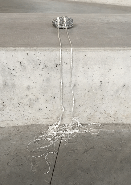 Veins Extended, 2016. Stone received as a gift, nylon cord.  © Freedom Baird