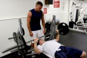 CAMP H.M. SMITH, Hawaii - Staff Sgt. Brett Garmon, G-4 air staff noncommissioned officer, U.S. Marine Corps Forces, Pacific, utilizes the bench press and weights, while safely being spotted by Master Sgt. Bill Atwater, G-4 maintenance management chief, MARFORPAC at the  Semper Fit Center here.