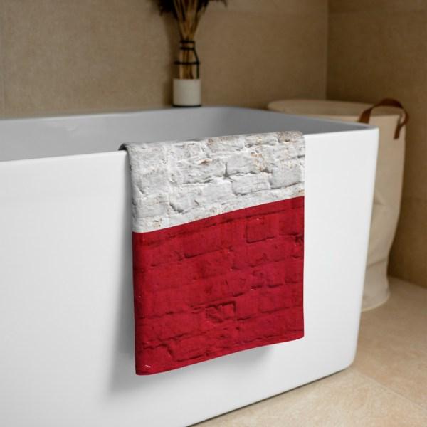 Beach and Bathroom Towel Texas Flag on Brick Wall folded on tub