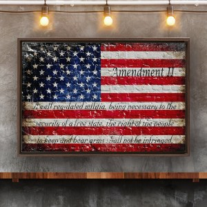 Distressed American Flag with the text of the 2nd Amendment painted on brick Wall.
