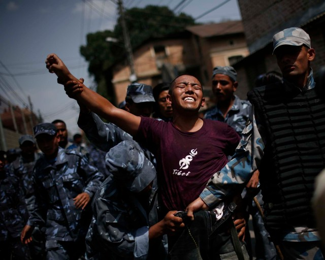 "China Katmandu Nepal pro-Tibetan demonstrator screams ""Free Tibet"""