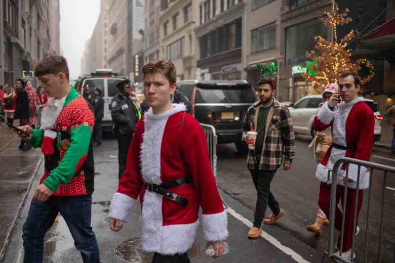 Santas bar-hopping at SantaCon 2019