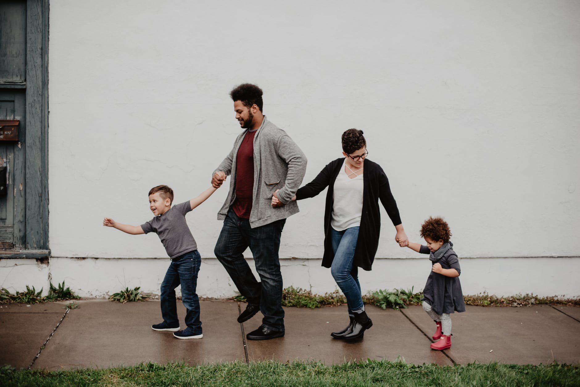 build wealth 30s family of four walking at the street