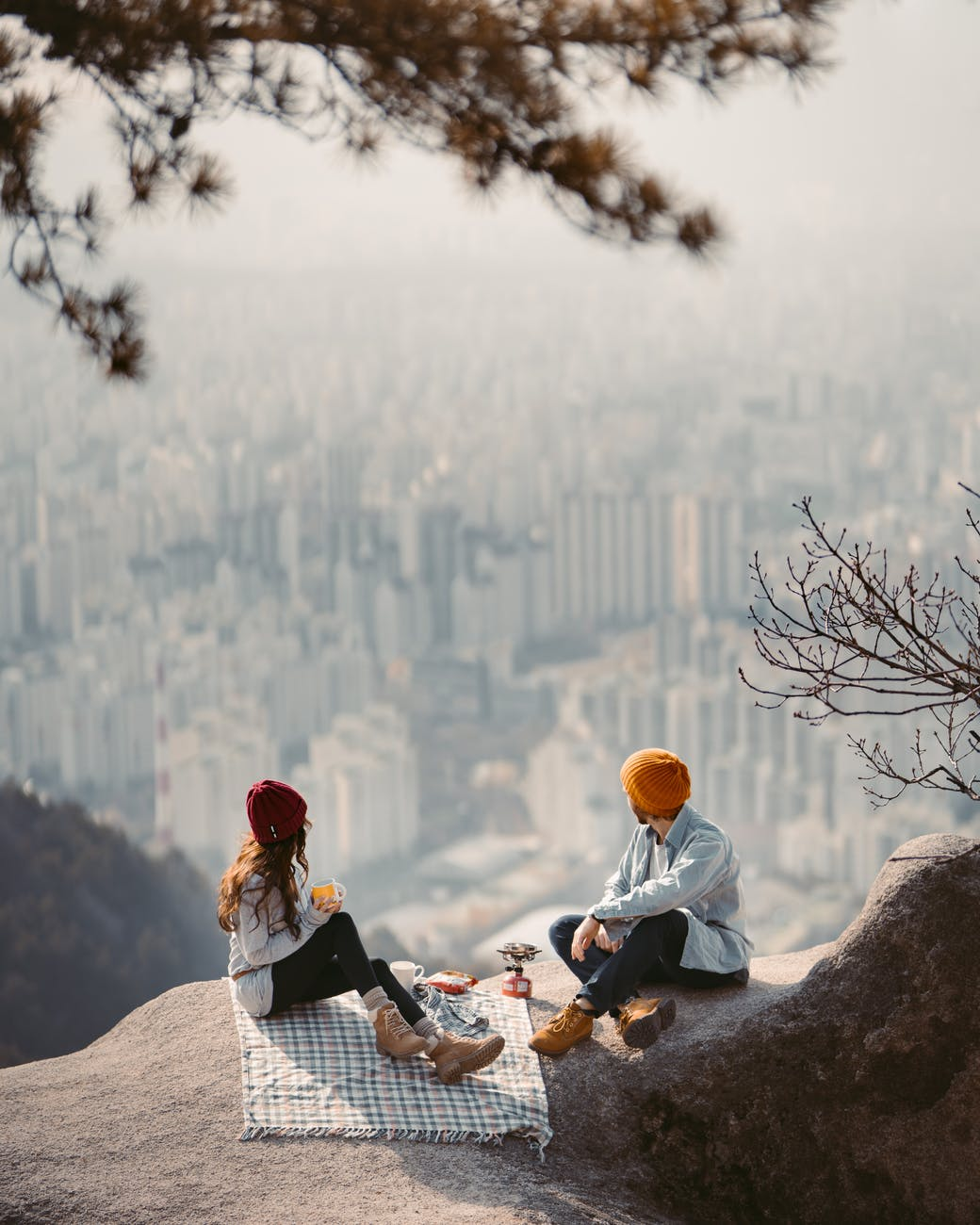 Small Business. a couple sitting on cliff having a picnic