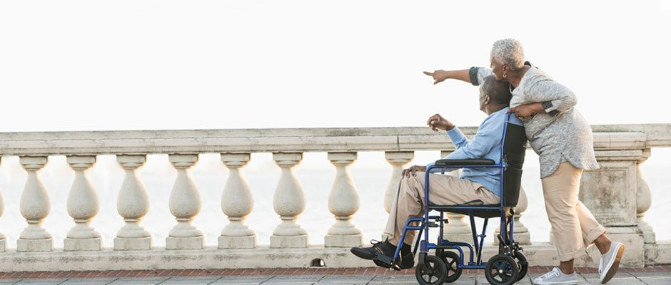 wheelchair-couple-on-boardwalk