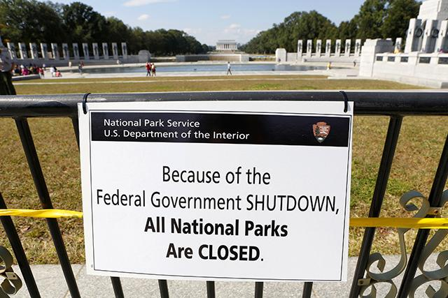 The Department of Interior Design says you can't walk on the grass or swim in the government pool. In the background, you can see some anarchists rallying against the government