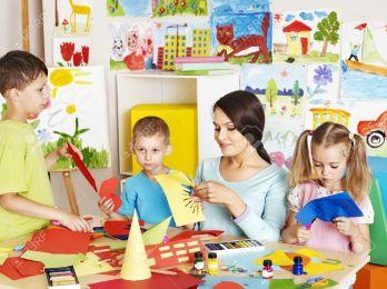 20724439-Happy-children-with-scissors-at-classroom--Stock-Photo-children-school-kindergarten