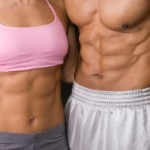 A couple showing off their toned stomach muscles.