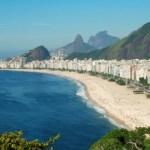 A photo of Copacabana beach and the surrounding city.