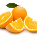 A whole and chopped orange on a white background.