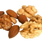 A selection of walnuts and almonds.