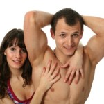 A muscular couple posing.