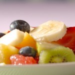A close up shot of a bowl of fruit salad.