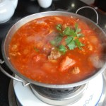 A large pot of beef and chilli soup.