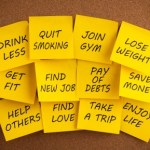 A selection of New Year goals written on yellow post it notes.
