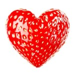 A red heart shaped strawberry.