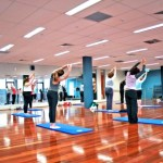 People exercising in a yoga class.