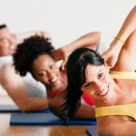 Three people in an exercise class.