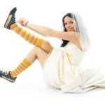 A bride wearing sports shoes.