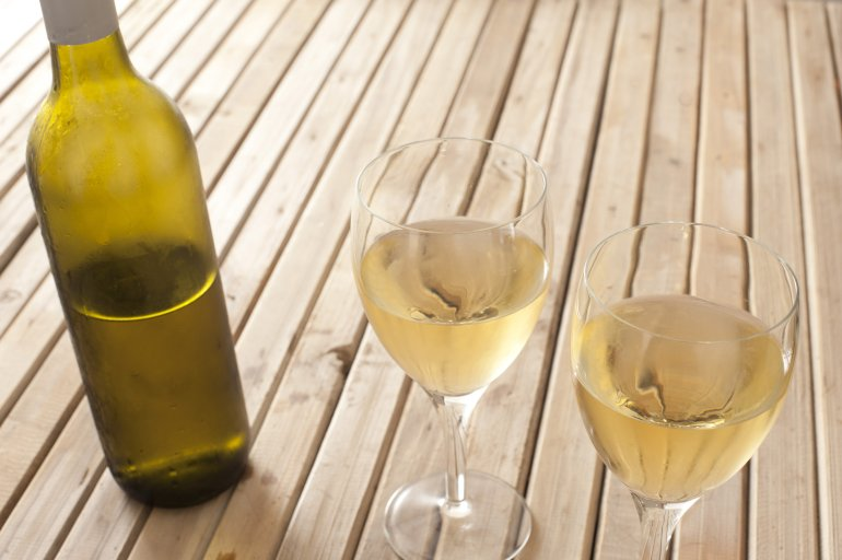 Glasses Of White Wine And A Bottle Free Stock Image