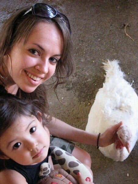 Author and illustrator Ruby Roth with her daughter at Animal Acres where rescued farm animals are given a second chance at life.
