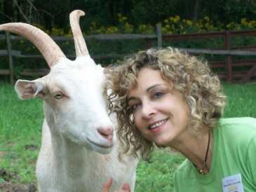 photo of Jamie Cohen with rescued goat Malcom